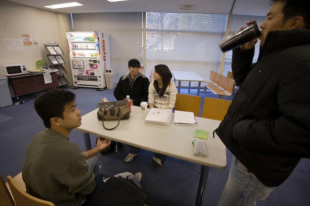Waseda  University.students.SB-1    4 year  program .center background.Shigehiro, Tsuruhara  Chicago, - Japanese/ American nationality..Marina  Eguchi  from Philadelphia  - Japanese / American nationality.in student lounge with other  students