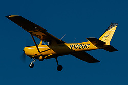 Cessna 152 (N102UC) with the You Can Fly Powered by AOPA Livery on approach to Palo Alto Airport (KPAO), Palo Alto, California, United States of America