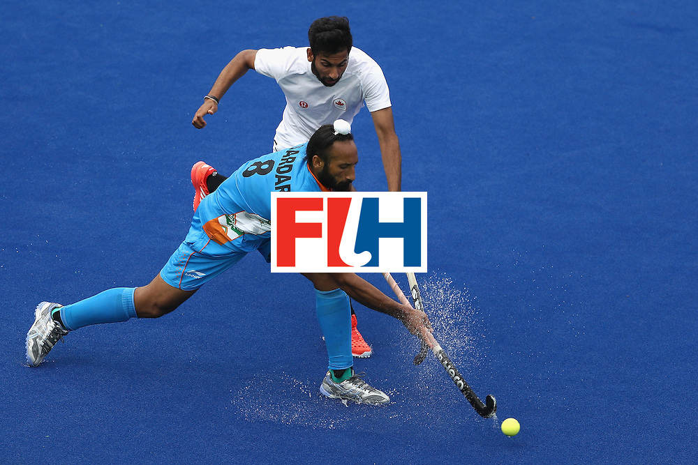 RIO DE JANEIRO, BRAZIL - AUGUST 12:  Sardar Singh #8 of India runs past Sukhi Panesar #27 of Canada during a Men's Preliminary Pool B match on Day 7 of the Rio 2016 Olympic Games at the Olympic Hockey Centre on August 12, 2016 in Rio de Janeiro, Brazil.  (Photo by Sean M. Haffey/Getty Images)