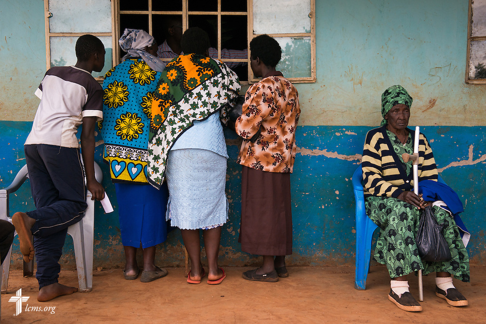 Residents queue at the pharmacy during the Mercy Medical Team clinic Tuesday, June 10, 2014, at the Luanda Doho Primary School in Kakmega County, Kenya. LCMS Communications/Erik M. Lunsford