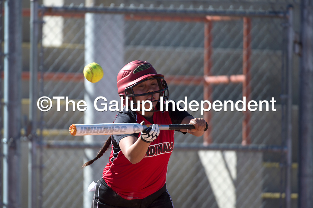 Saint Michaels Cardinal Julianne Billiman (12) bunts the ball during the game against Wingate at Ford Canyon Park in Gallup Tuesday.