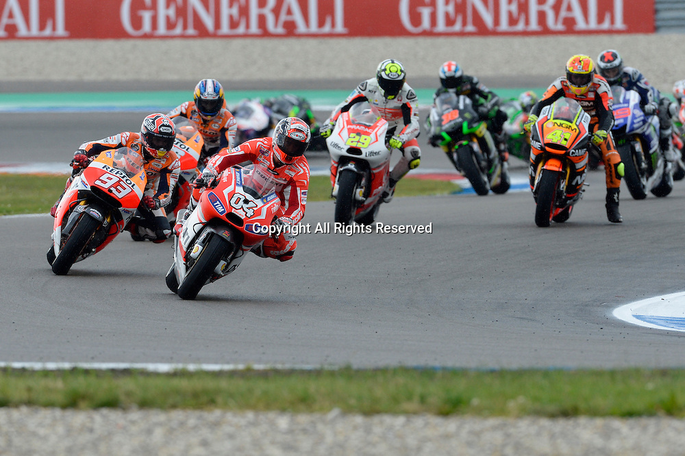 28.06.2014.  Assen, Netherlands. MotoGP. Iveco Daily TT Assen Race.Andrea Dovizioso (Ducati Team) and Marc Marquez(Repsol Honda Team) during the TT Assen race.