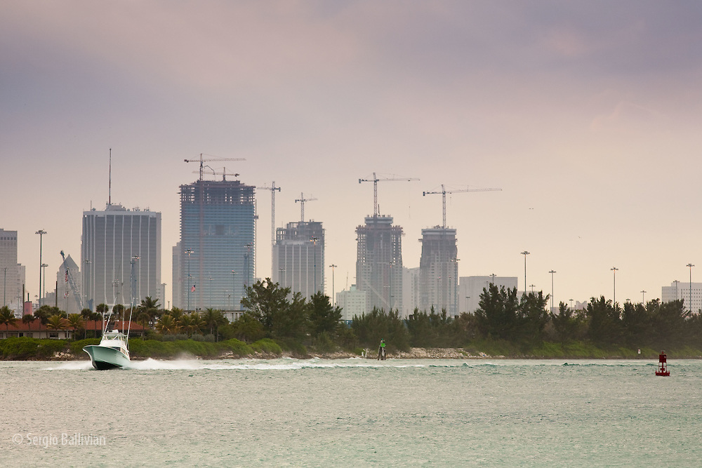 The soft light and calm waters frame the new buildings of the ever-growing skyline of Miami Beach, Florida.
