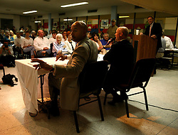 May 10th, 2006. New Orleans, Louisiana. New Orleans Mayor Ray C Nagin debates his challenger, Louisiana lieutenant governor Mitch Landrieu at the Audubon Institute Riverside association at the Sabis Academy Charter school in Uptown New Orleans. Nagin reaches for a bottle of water from an aide.<br /> Photo; Charlie Varley/varleypix.com