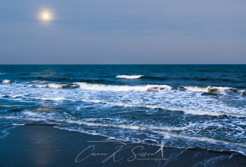 """The moon rises over the Washout on Folly Beach, April 3, 2015, in Folly Beach, South Carolina. The beach, known for its prime surfing spots like the Washout, is known as """"the Edge of America"""" by locals. (Photo by Carmen K. Sisson/Cloudybright)"""