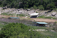 Boat Houses along Pedrenales River as it enters Lake Travis.