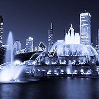 Photo of Chicago at night with Buckingham Fountain and the Chicago skyline. Officially named the Clarence F. Buckingham Memorial Fountain, the fountain is a very popular attraction located in Grant Park in downtown Chicago. Photo is high resolution, toned blue, and was taken in 2012.