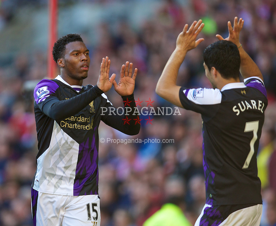 SUNDERLAND, ENGLAND - Sunday, September 29, 2013: Liverpool's Daniel Sturridge celebrates scoring the first goal against Sunderland with team-mate Luis Suarez during the Premiership match at the Stadium of Light. (Pic by David Rawcliffe/Propaganda)