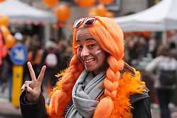 April 27, 2019 - Amsterdam, Netherlands - A woman on the street at the Prinsengracht canal celebrates King's Day on April 27, 2019 in Amsterdam,Netherlands.The King's day (Koningsdag)  marking the birth of King Willem-Alexander. In the Netherlands, King Willem-Alexander's 52th birthday is celebrated during the traditional Kingsday. (Credit Image: © Paulo Amorim/NurPhoto via ZUMA Press)