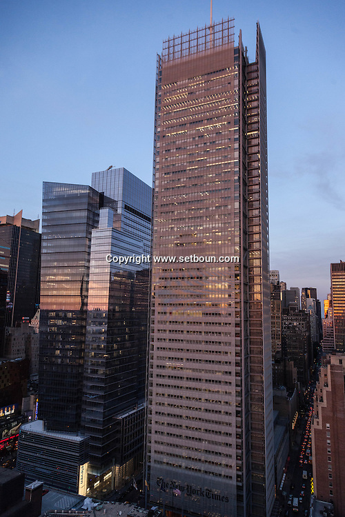 New york times new tower and 11 times square in midtown , mirror games at sunset on times square skyline