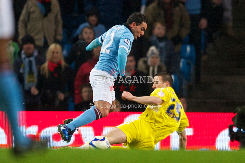 MANCHESTER, ENGLAND - Tuesday, January 18, 2011: Manchester City's Carlos Tevez is brought down by Leicester City's Jack Hobbs for a penalty during the FA Cup 3rd Round Replay match at the City of Manchester Stadium. (Photo by David Rawcliffe/Propaganda)