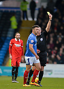 Portsmouth defender Enda Stevens shown the yellow card during the Sky Bet League 2 match between Portsmouth and Leyton Orient at Fratton Park, Portsmouth, England on 6 February 2016. Photo by Adam Rivers.