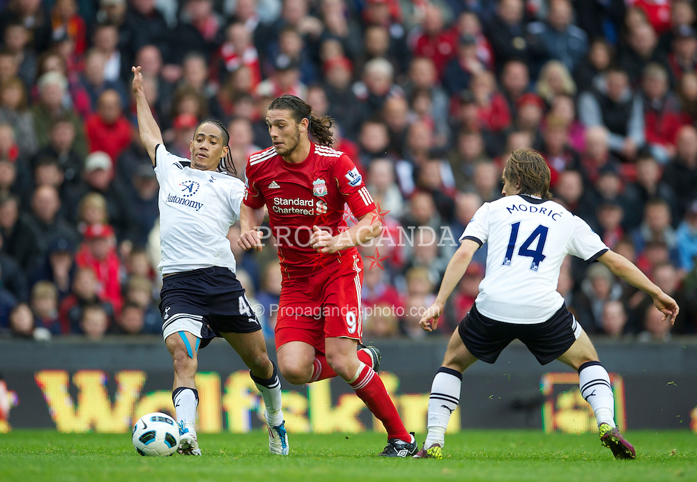 LIVERPOOL, ENGLAND - Sunday, May 15, 2011: Liverpool's Andy Carroll and Tottenham Hotspur's Steven Pienaar during the Premiership match at Anfield. (Photo by David Rawcliffe/Propaganda)