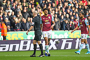 Tyrone Mings of Aston Villa receives a yellow card during the Premier League match between Wolverhampton Wanderers and Aston Villa at Molineux, Wolverhampton, England on 10 November 2019.