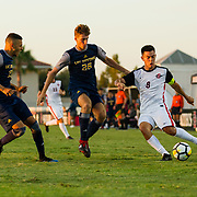 09 September 2018:San Diego State Aztecs midfielder Pablo Pelaez (8) crosses the ball into the box past two UC Irvine defenders in the second half.  The San Diego State men's soccer team beat UC Irvine in overtime 2-1 Sunday afternoon at the SDSU Sports Deck.