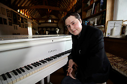 UK ENGLAND THAME 27AUG14 - Robin John Gibb, son of Bee Gee Robin Gibb poses for a photo at the white piano in the rectory of their home in Thame, Oxfordshire.<br /> <br /> jre/Photo by Jiri Rezac<br /> <br /> © Jiri Rezac 2014