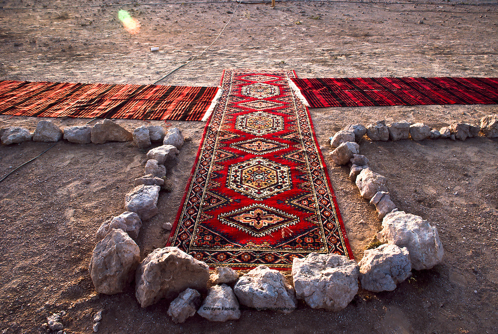 The direction toward Makkah may be marked by an arrangement of stones, an arch in the sand or a rug positioned for prayers.  As faithful Muslims, the Bedouin we lived with prayed five times a day.