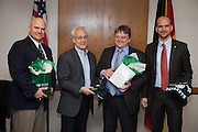 Left to Right Dr. B. David Ridpath, Dr. Hugh Sherman, Dean of OHIO College of Business,  and Professor Herbert Woratschek of University of Bayreuth and Tim Strobel exchange gifts before signing a Memoradum of Understanding on Monday March 17, 2014.  Photo by Ohio University / Jonathan Adams