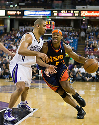 November 8, 2009; Sacramento, CA, USA;  Golden State Warriors forward Corey Maggette (50) is defended by Sacramento Kings forward Ime Udoka (3) during the first quarter at the ARCO Arena. The Kings defeated the Warriors 120-107.