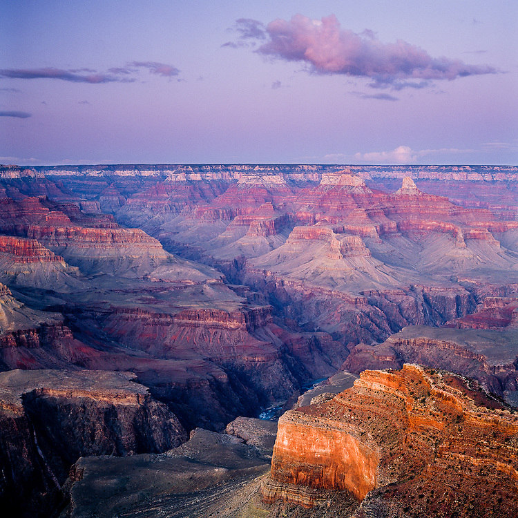 After sunset, the Grand Canyon is lit by the remaining light reflecting off the atmosphere.