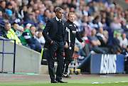 Chris Hughton on the touchline during the Sky Bet Championship match between Bolton Wanderers and Brighton and Hove Albion at the Macron Stadium, Bolton, England on 26 September 2015.