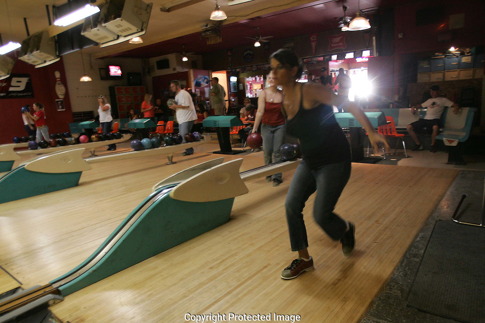 Angie Price takes a practice roll on league night at Grove City Lanes. (Jodi Miller/Alive)