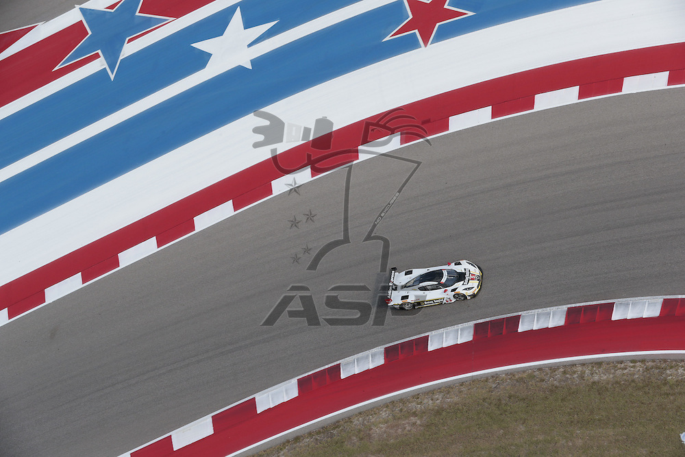 Austin, TX - Sep 15, 2016:  The Action Express Racing Prototype Corvette DP car races through the turns at the Lone Star Le Mans at Circuit of the Americas in Austin, TX.