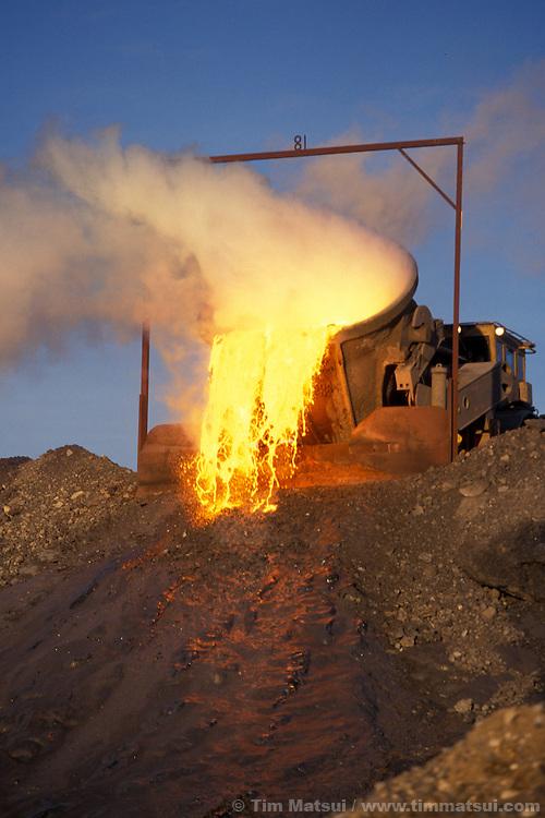 Discarding molten slag..