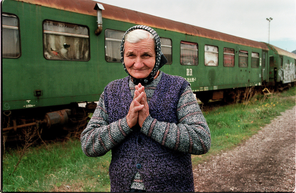 CAPLJINA, BOSNIA-HERZEGOVINA:  An elderly resident of the 'train wagon' refugee camp in Capljina. The old, disused railway carriages latched together in long, parallel lines, sit in a railway yard 26km south of Mostar. They provided shelter for hundreds of ethnically cleansed, displaced people during the Bosnian war.  (Photo by Robert Falcetti).