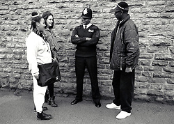 Teenagers with policeman Nottingham, UK 1990s