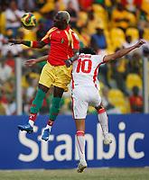 Photo: Steve Bond/Richard Lane Photography.<br />Guinea v Morocco. Africa Cup of Nations. 24/01/2008. Tarik Sektioui (R) and Mohamed Cisse (L) go for a high ball