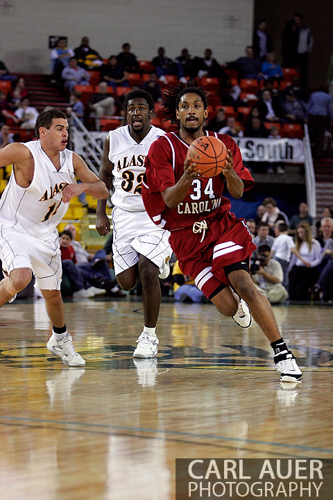 24 November 2005:Junior forward Renaldo Balkman (34) from the University of South Carolina looks for a pass as he brings the ball down court in the Gamecock's 65 - 60 victory over the University of Alaska Anchorage Seawolves in the first round of the Great Alaska Shootout at the Sullivan Arena in Anchorage Alaska.
