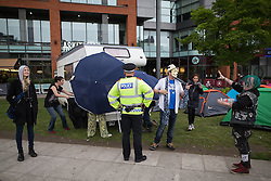 © Licensed to London News Pictures . 03/10/2015 . Manchester , UK . A homeless protest camp featuring tents and a caravan parked on Piccadilly Gardens . Protesters against the Conservative government's policies hold a non-stop rave in Piccadilly Gardens in Manchester City Centre ahead of the Conservative Party's annual conference . Photo credit: Joel Goodman/LNP