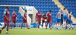 COLCHESTER, ENGLAND - Saturday, September 25, 2010: Things get worse for Tranmere Rovers' players feel dejected as Colchester United's Magnus Okuonghae (Center Right) celebrates after his goal makes it 3-0 during the League One match at the Colchester Community Stadium. (Photo by Gareth Davies/Propaganda)