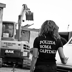 """On September 28, 2012, after 16 years, about 250 romani families, mostly Bosnians, are forcibly evicted from the Tor de' Cenci camp in Rome in violation of international standards on evictions and without being offered an adequate housing alternative. The closure of this camp is part of the Nomad Plan, which aims to close Rome's informal and """"tolerated"""" camps, and resettle their residents in authorized camps. The italian romani communities live in a perpetual condition of 'freeze' and 'suspension' despite the government's promises to take serious social inclusion policies. This condition also denies to the romani communities the possibility of producing specific projections for their future lives."""
