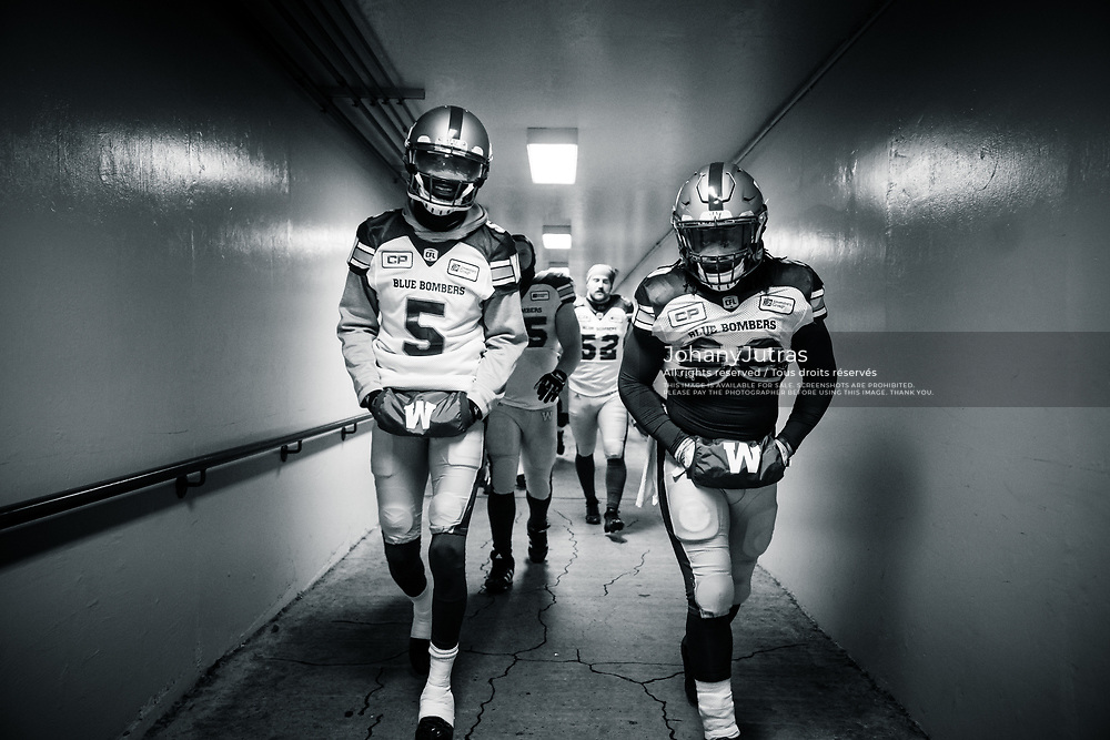 L'Damian Washington (5) and Timothy Flanders (20) and teammates of the Winnipeg Blue Bombers before the game against the Calgary Stampeders at McMahon Stadium in Calgary, AB, Friday Nov. 3, 2017. (Photo: Johany Jutras)