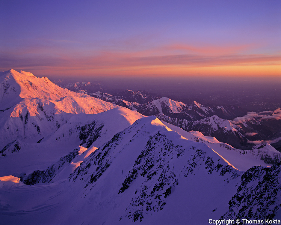 Snow Capped Mountains at Sunset