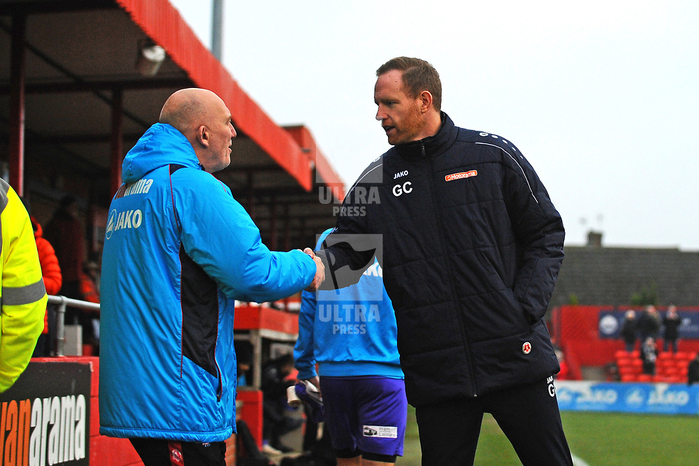 TELFORD COPYRIGHT MIKE SHERIDAN Gavin Cowan greets Alfreton manager Billy Heath during the Vanarama Conference North fixture between AFC Telford United and Alfreton Town at The Impact Arena on Wednesday, January 1, 2020.<br />