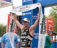 Andy Potts of Colorado Springs, CO wins the 2013 Ironman 70.3 Timberman Triathlon at Ellacoya State Beach on Sunday.  (Karen Bobotas/for the Laconia Daily Sun)