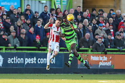 Forest Green Rovers Isaiah Osbourne(34) and Cheltenham Town's Joe Morrell(25) clash during the EFL Sky Bet League 2 match between Forest Green Rovers and Cheltenham Town at the New Lawn, Forest Green, United Kingdom on 25 November 2017. Photo by Shane Healey.