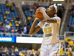 West Virginia Mountaineers guard Bria Holmes (23) shoots a three pointer against the Oklahoma Sooners during the second half at the WVU Coliseum.