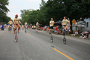 09: CIRCUS PARADE UNICYCLISTS