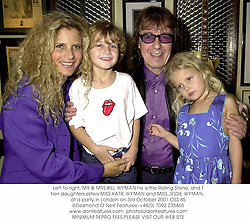 Left to right, MR & MRS BILL WYMAN he is the Rolling Stone, and their daughters sisters MISS KATIE WYMAN and MISS JESSIE WYMAN, at a party in London on 3rd October 2001.OSS 65