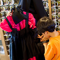 "Haya Almekemi and Moaath, 5, visiting from Kuwait, shop for an example of Amish girls's clothes at the gift shop within the Amish Experience, an immersive tourism destination in Bird in Hand, PA on August 9, 2014.  A bevy of Amish themed reality television shows (Amish Mafia, Breaking Amish, Return to Amish and Amish Haunting - to be televised soon) have prompted controversy over the negative portrayal.  One woman, a Mary Haverstick, a film maker, has launched a website in support of the Amish (respectamish.org) and has garnered the support of 3,000 businesses.  Her motivation to start the website was to ""end the bigoted programming.""  REUTERS/Mark Makela (UNITED STATES)"