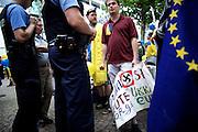 Frankfurt am Main | 05 July 2014<br /> <br /> Am Samstag (05.07.2014) demonstrierten am Domplatz in Frankfurt am Main etwa 25 Menschen f&uuml;r die Unabh&auml;ngigkeit der Ukraine und gegen den Einfluss von Russland.<br /> Hier: Demonstranten mit einem Plakat mit der Aufschrift &quot;Putin Stop - Heute Ukraine - Morgen Europa&quot; und einem Hakenkreuz. Polizeibeamte beschlagnahmen das Transparent, da die Zurschaustellung des Hakenkreuzes in der &Ouml;ffentlichkeit strafbar ist.<br /> <br /> [Foto honorarpflichtig, kein Model Release]<br /> <br /> &copy;peter-juelich.com