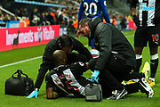 Jetro Willems (#15) of Newcastle United receives treatment for an injury during the Premier League match between Newcastle United and Chelsea at St. James's Park, Newcastle, England on 18 January 2020.