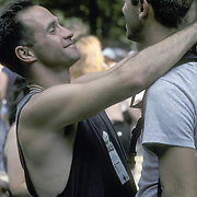 Affectionate gay couple  being intimate hugging during gay pride week in NYC