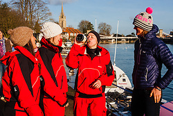 Marlow, Bucks, January 24th 2015. Olympic and Paralympic rowing medallists including Naomi Riches, Heather Stanning and Katherine Grainger join members of a Coxless Crew at Marlow at their boat naming ceremony. The Coxless Crew is a team of four women who have given up their jobs to undertake an epic six-month 8,446 mile adventure rowing their boat Doris across the Pacific ocean from Sanfrancisco to Cairns in Australia, to raise funds for charities Walking With The Wounded and Breast Cancer Care. PICTURED: Coxless Crew's Emma Mitchell, watched by Natalia Cohen (left) and Laura Penhaul enjoys a swig of champagne after the naming of theitr boat Doris by Olympic rower Heather Stanning, right.