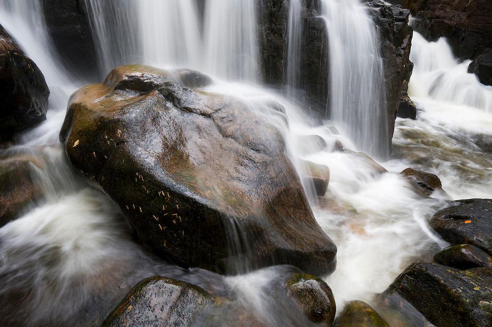 Boulder in falls at Coire Mhic Nobuil, Torridon, Scotland