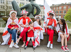 19/04/2014.  Members of the Foster family enjoy the annual St Georges Day celebration in Birmingham city centre's Victoria Square today.  Photo credit: Alison Baskerville/LNP